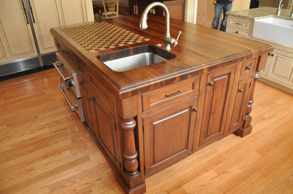 Ideas for creating custom kitchen islands cabinets by graber for Kitchen island with cupboards